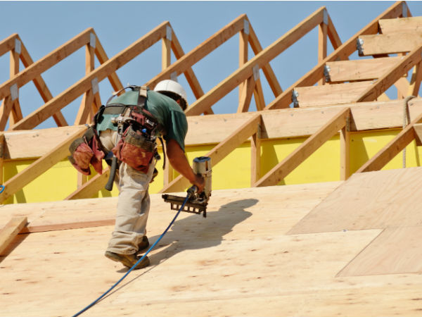 This is an image of a roofing contractor installing a new roof on a residential property.