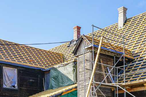 This is an image of a roof structure repair on a historic wooden house.