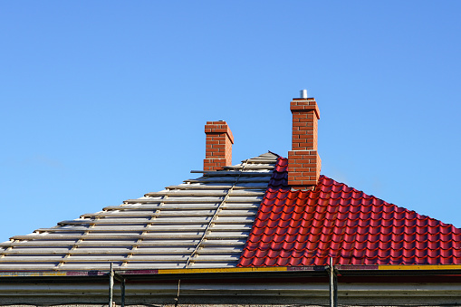 This is an image of a roof replacement on a residential house.