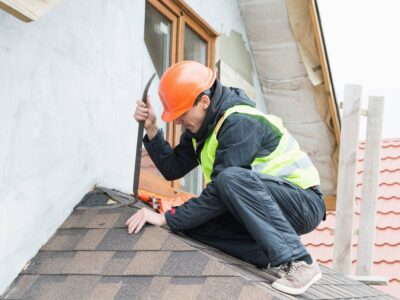 This is an image of a roofing contractor fixing a leaking roof.